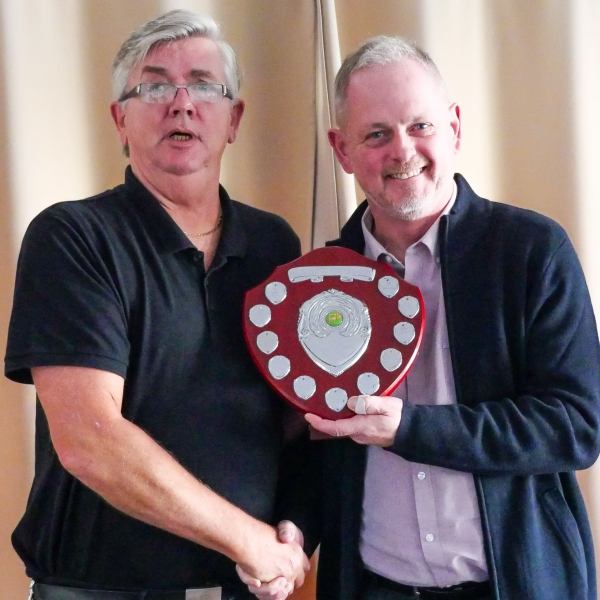 David Cornes (Crake) receiving the HGC league trophy from Fed Chairman Paul Rigge