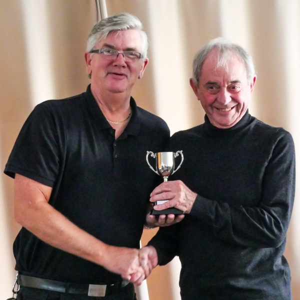 Alan Clare (Chester Centurions) receiving the LPGC league trophy from Fed Chairman Paul Rigge