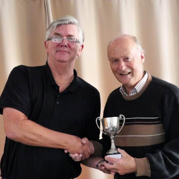 Jerry Guest (Chester)  receiving the B Level Adv AC league trophy from Fed Chairman Paul Rigge