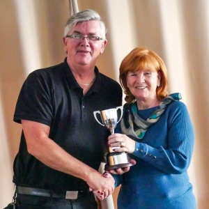 Vi Richards (Bury)  receiving the Short AC league trophy from Fed Chairman Paul Rigge