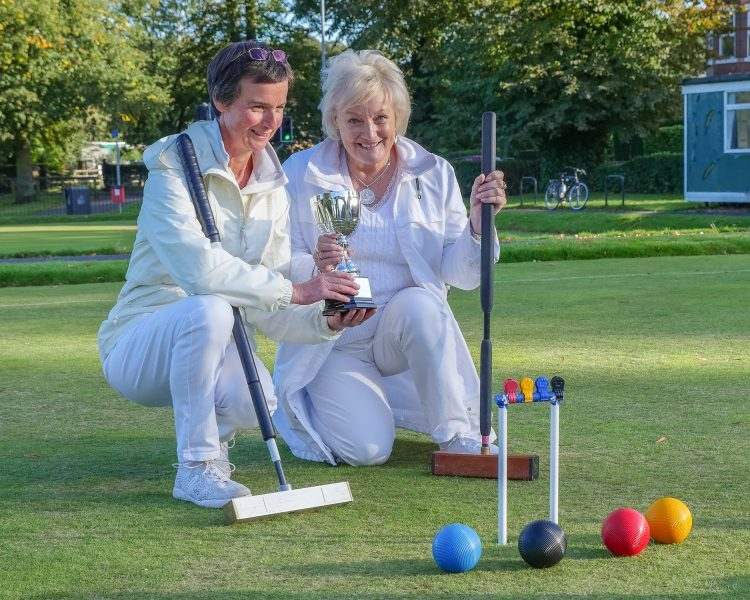Tina Kelly (right) receiving the York Short Croquet Trophy from 2017 Winner, Debbie James (left).   (Photo Kath Thomas)