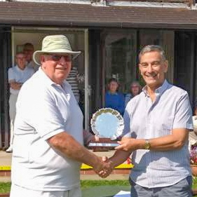 Michael Sandler presents winner Brian Kerr with the B-Class trophy