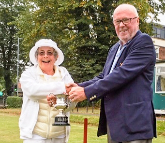 Colin Irwin presents Cas Sinclair with the national Short Croquet trophy