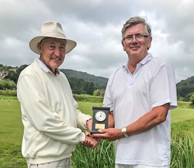 Jim Allcock presents Paul Rigge with the Cavendish Clock