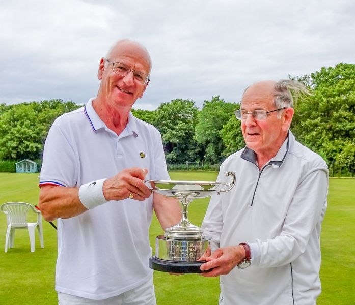 Southport President Alan Pidcock presents the Hawkins Cup to Derek Knight, B Level Winner.