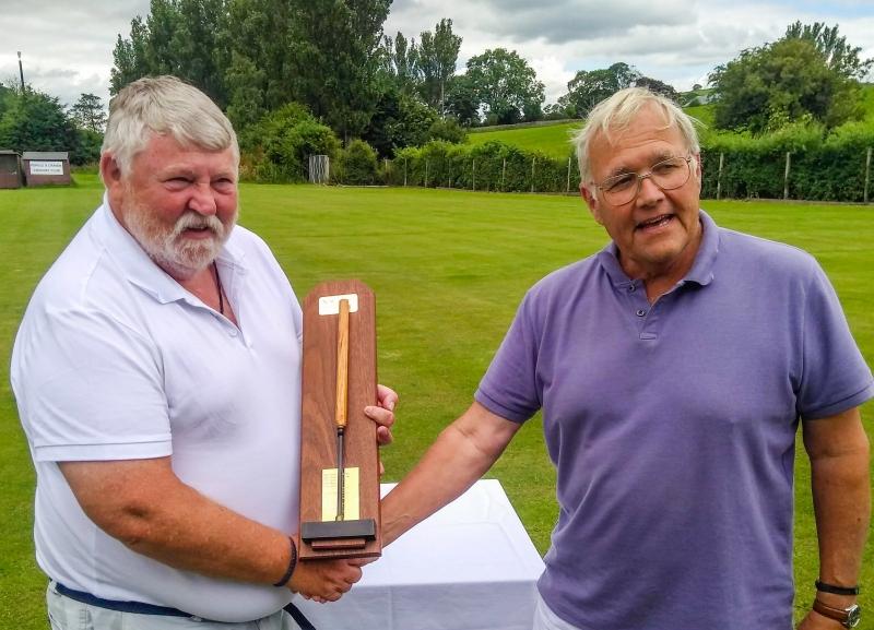 Robert Essler (Pendle) presents the winning trophy to Dave Williamson (Crake).
