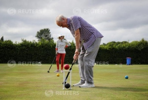 People play croquet at Chester Croquet Club in Westminster Park, following the outbreak of the coronavirus disease (COVID-19), Chester, Britain, June 12, 2020. REUTERS/Molly Darlington