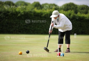 A woman plays croquet at Chester Croquet Club in Westminster Park, following the outbreak of the coronavirus disease (COVID-19), Chester, Britain, June 12, 2020. REUTERS/Molly Darlington
