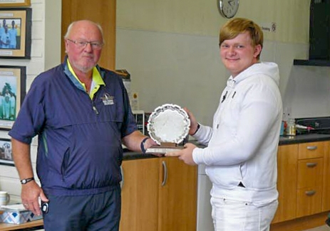 Adam Swinton receives the Sheila Black Trophy from Colin Irwin