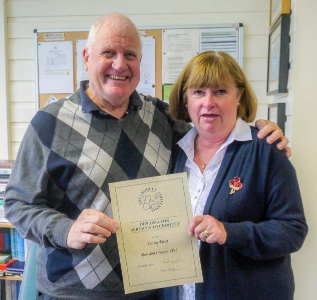 Lorna Frost receiving her CA Diploma for services too Croquet, from Brian Storey, Secretary of Bowdon CC.