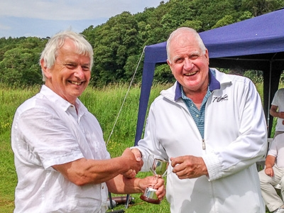 Brian Storey being presented with the Cumbria Cup by Crake Chairman Tom Griffiths