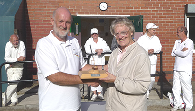 Bob Thompson being presented with 2010 Bury Handicap Trophy by Bury Chairman, Barbara Young.