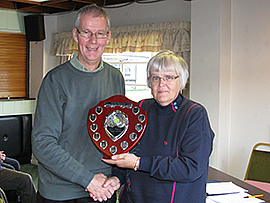 Federation chairman David Barratt presents the 2010 Golf League trophy to Anwen Williams of Llanfairfechan