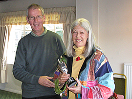 Federation chairman David Barratt presents the 2010 Short League trophy to Carolyn Ratcliffe of Llanfairfechan