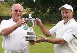 Bury Captain, Mac Hardman, receiving the Longman Cup from Stephen Mulliner.