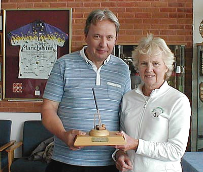 Paul Kenworthy (Bury CC Chairman) presents 2013 Manchester Handicap Trophy to Winner Margaret Anderton (Bury)