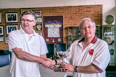 Robert Essler being presented with the Woodlands Trophy by Manager Paul Rigge
