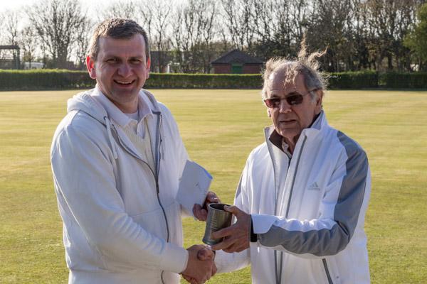 Winner Matt Holmes receives Jubilee Tankard from Southport President Alan Pidcock
