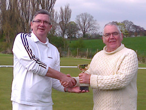 Roger Schofield being presented with the John Beech Trophy by Manager Paul Rigge