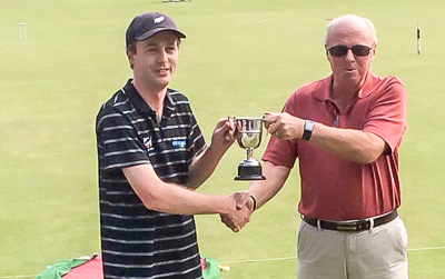 Paddy Chapman receiving the Peterson Cup from Bowdon President, Colin Irwin