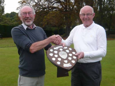 Winning Bowdon Captain, Alan Mayne, being presented with the Secretary's Shield by Dr Ian Vincent