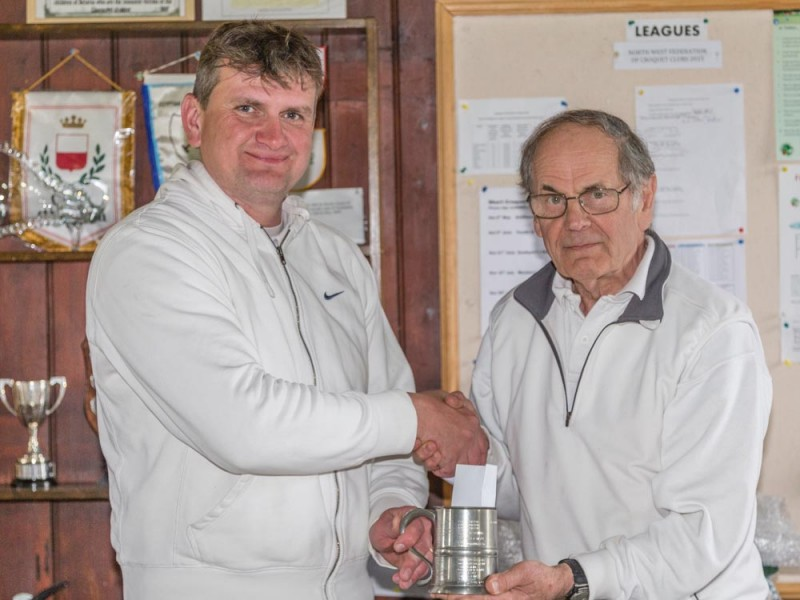 Matt Holmes (Bury) being presented with the Southport Advanced Jubilee Tankard by Southport President Prof. Alan Pidcock.