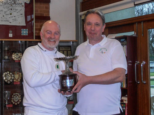 David Walters receives the Lancashire Open Golf trophy from Bury Chair Paul Kenworthy