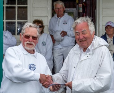 Barry Keen (Tournament Referee) presents the runners up prize to Don Williamson