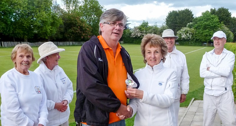 Paul Rigge (Bury) being presented with the Federation Millenium Level Play Golf Croquet trophy by Manager Pat Clare of Chester.