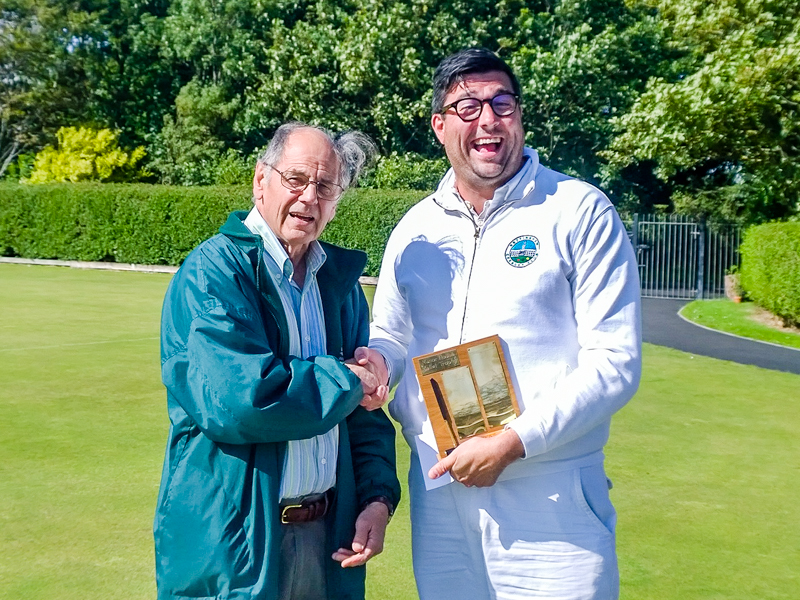 Omied Hallam receives the Manor House Super B trophy from Southport President Prof Alan Pidcock (Photo Ray Lowe)