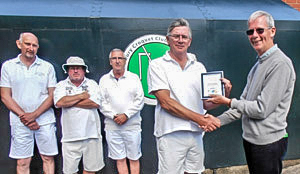 David Barratt presents the Federation Millennium Level Play Golf Croquet trophy to winner Paul Rigge