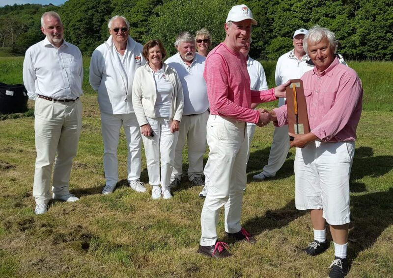 Crake Chairman Tom Griffiths presents the Millennium Handicap Trophy to winner David Lloyd