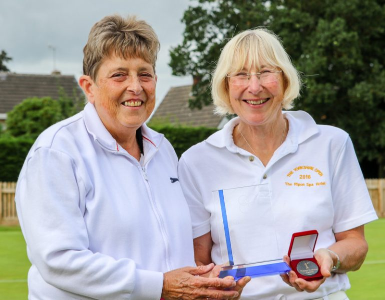 Maggie Cowman presents the inaugural trophy to Kath Wright